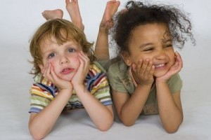 495593-a-beautiful-mixed-race-girl-and-a-blonde-boy-playing-together-one-happy-one-sad