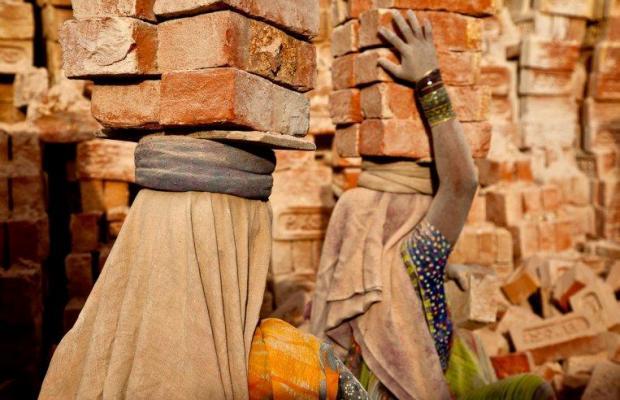 women crrying brick